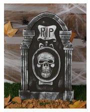 Grabstein RIP und Totenschädel