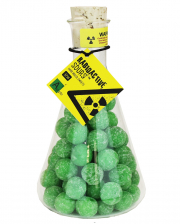 Radioactive Sour Apple Drops In A Glass Flask