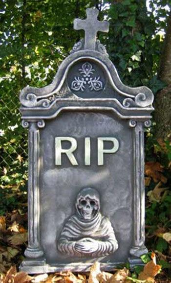 Grabstein mit Kreuz u. Skull