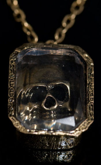 Brass colored skull necklace