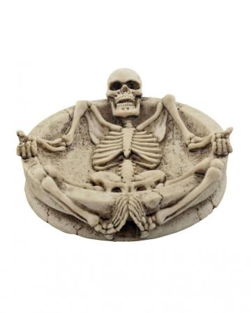 Ashtray with lying skeleton